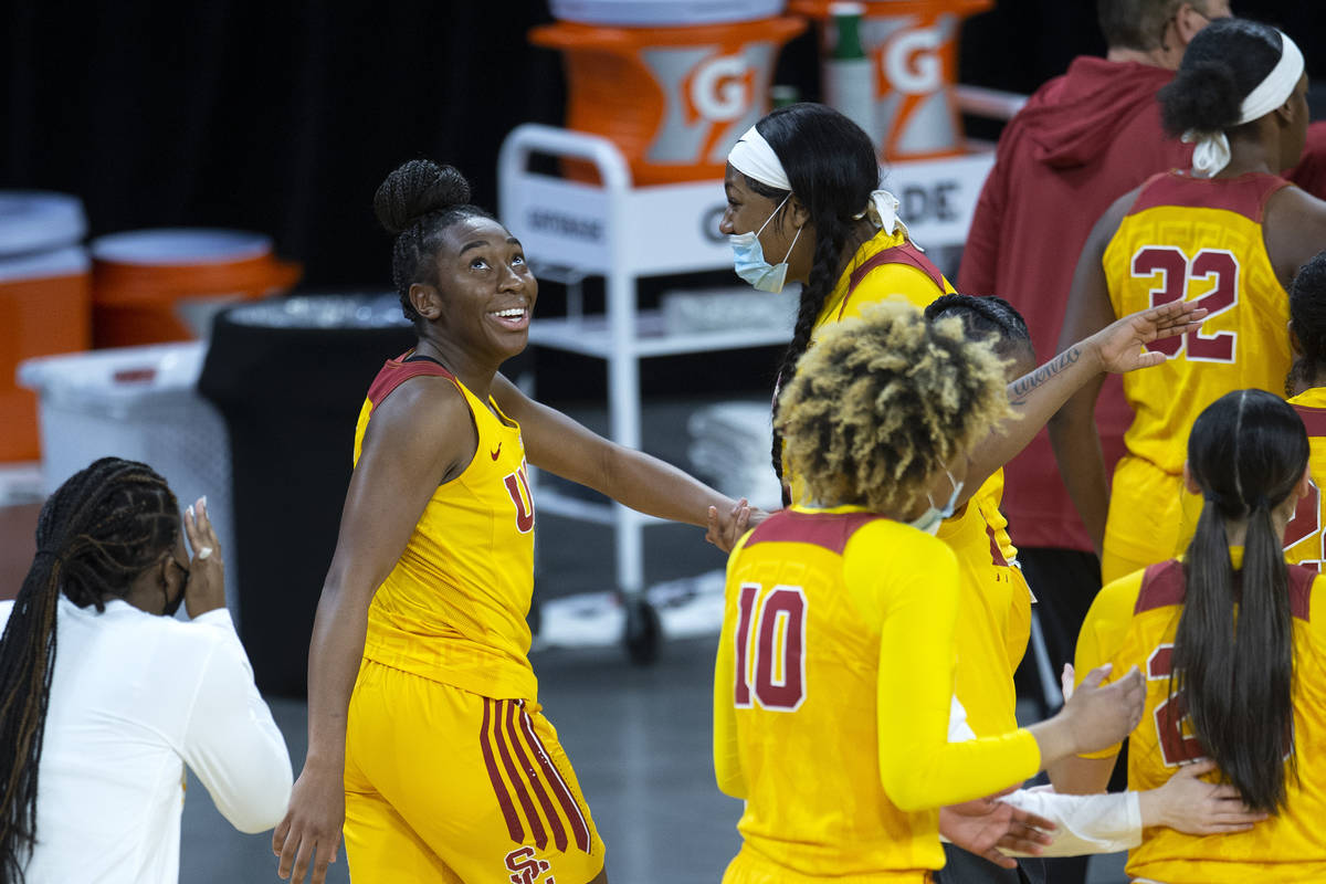 USC Trojans forward Jordan Sanders (5) looks at the playback of herself scoring a point against ...