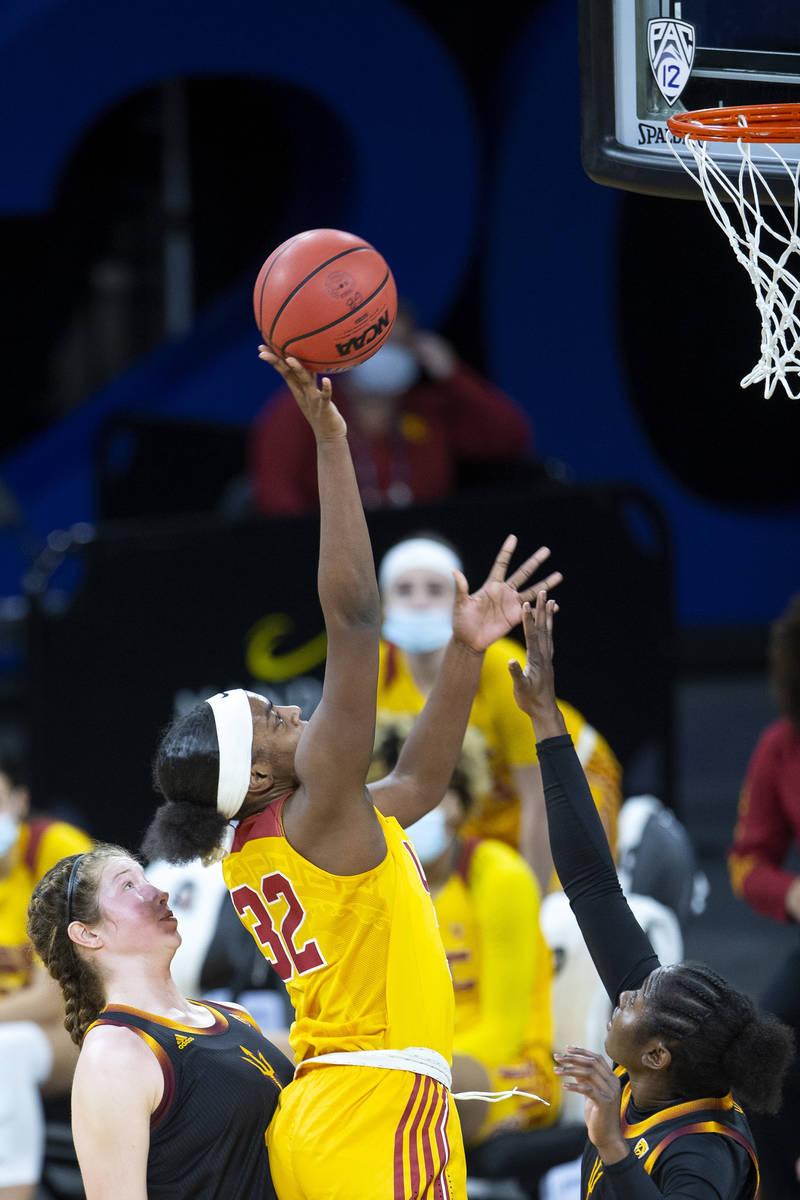 USC Trojans forward Jordyn Jenkins (32) shoots a point as Arizona State Sun Devils guard Maggie ...