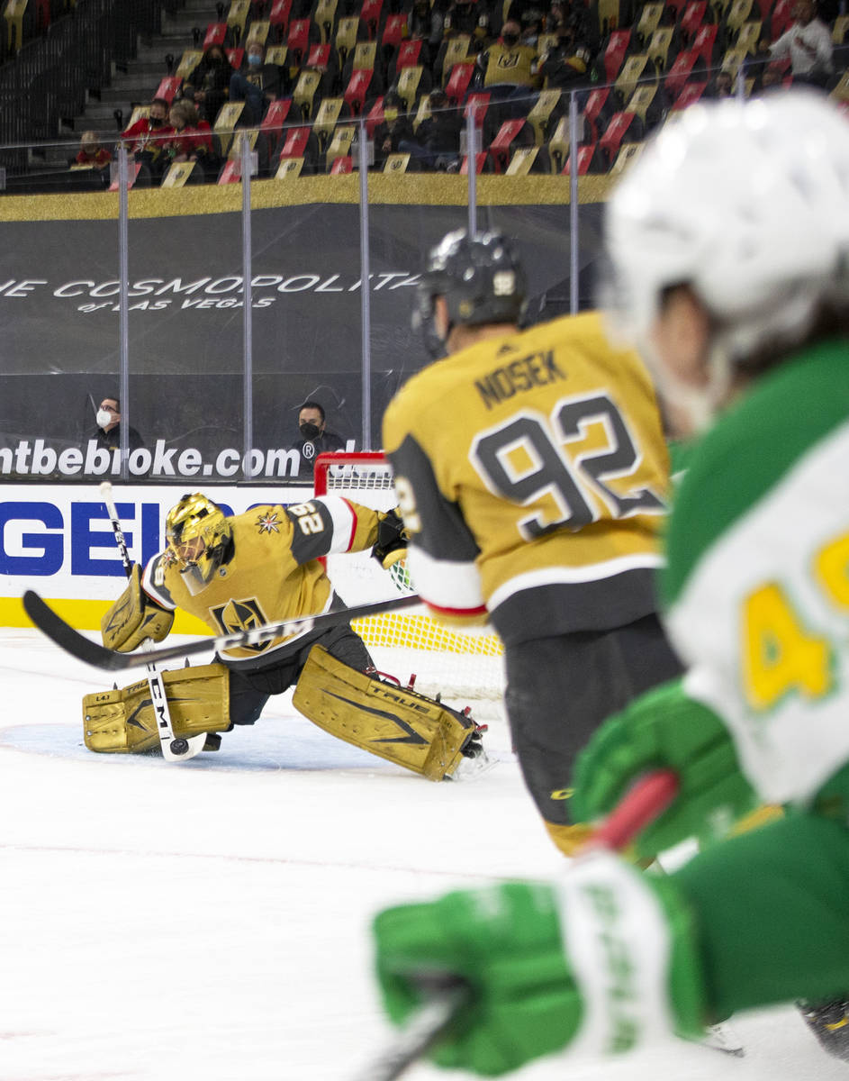 Golden Knights goaltender Marc-Andre Fleury (29) saves a shot on goal by the Minnesota Wild dur ...
