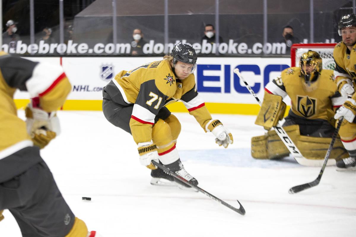 Golden Knights center William Karlsson (71) skates for the puck as Golden Knights goaltender Ma ...