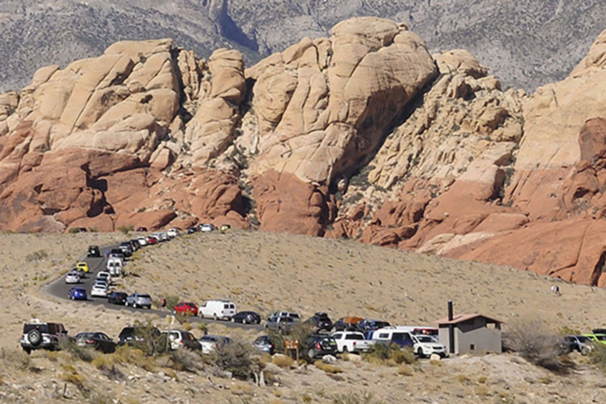 Parked vehicles stretch along the Red Rock Loop Road on a busy day at the Red Rock National Con ...