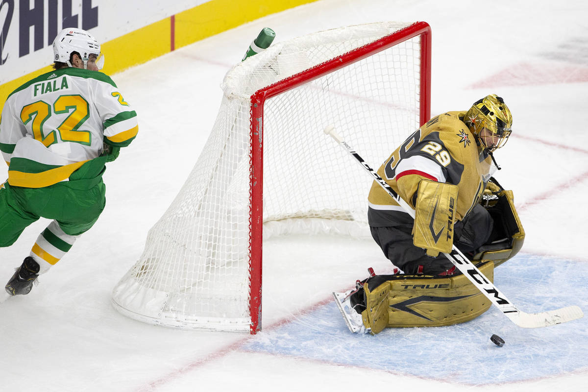 Golden Knights goaltender Marc-Andre Fleury (29) save a shot on goal from Wild left wing Kevin ...