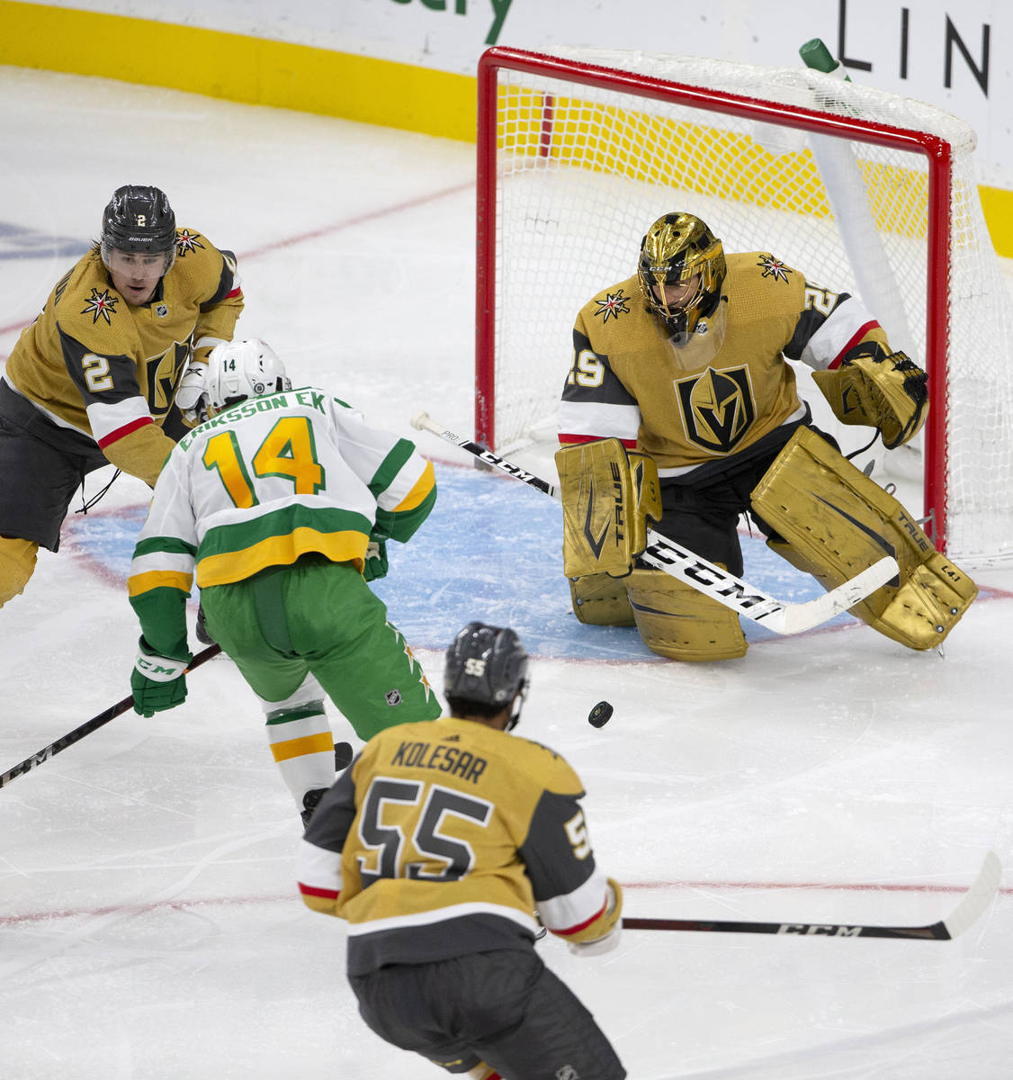 Golden Knights goaltender Marc-Andre Fleury (29) is about to save a shot on goal by Wild center ...