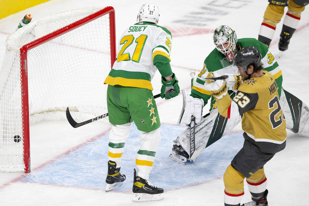 Wild goaltender Cam Talbot (33) lets in a goal shot by Golden Knights right wing Mark Stone (61 ...