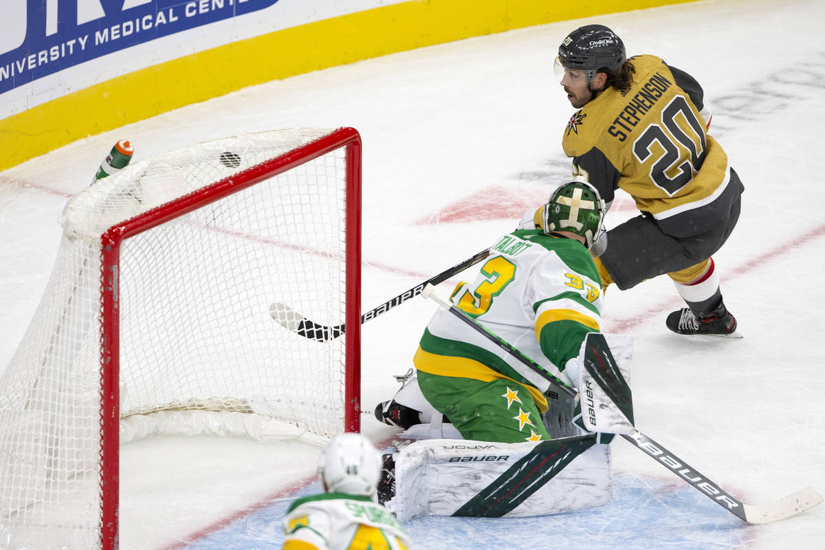 Golden Knights center Chandler Stephenson (20) scores a goal on Wild goaltender Cam Talbot (33) ...
