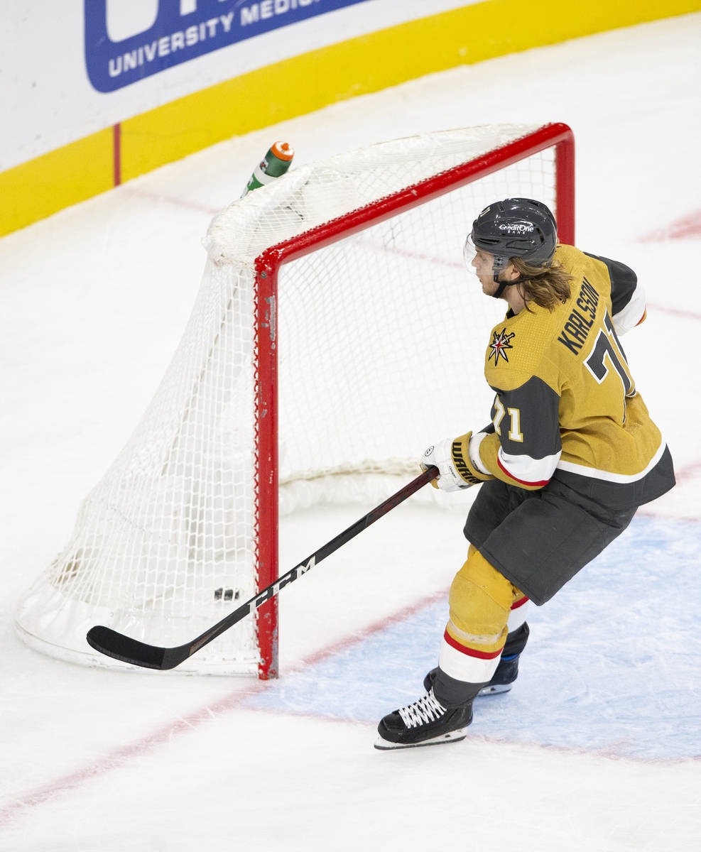 Golden Knights center William Karlsson (71) scores a goal on the Wild's empty net during the th ...