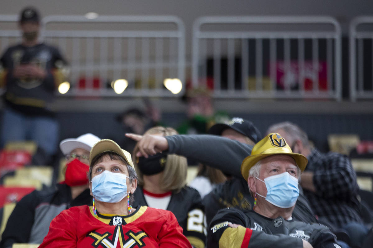Golden Knights fans wear personal protective equipment to prevent the spread of COVID-19 before ...