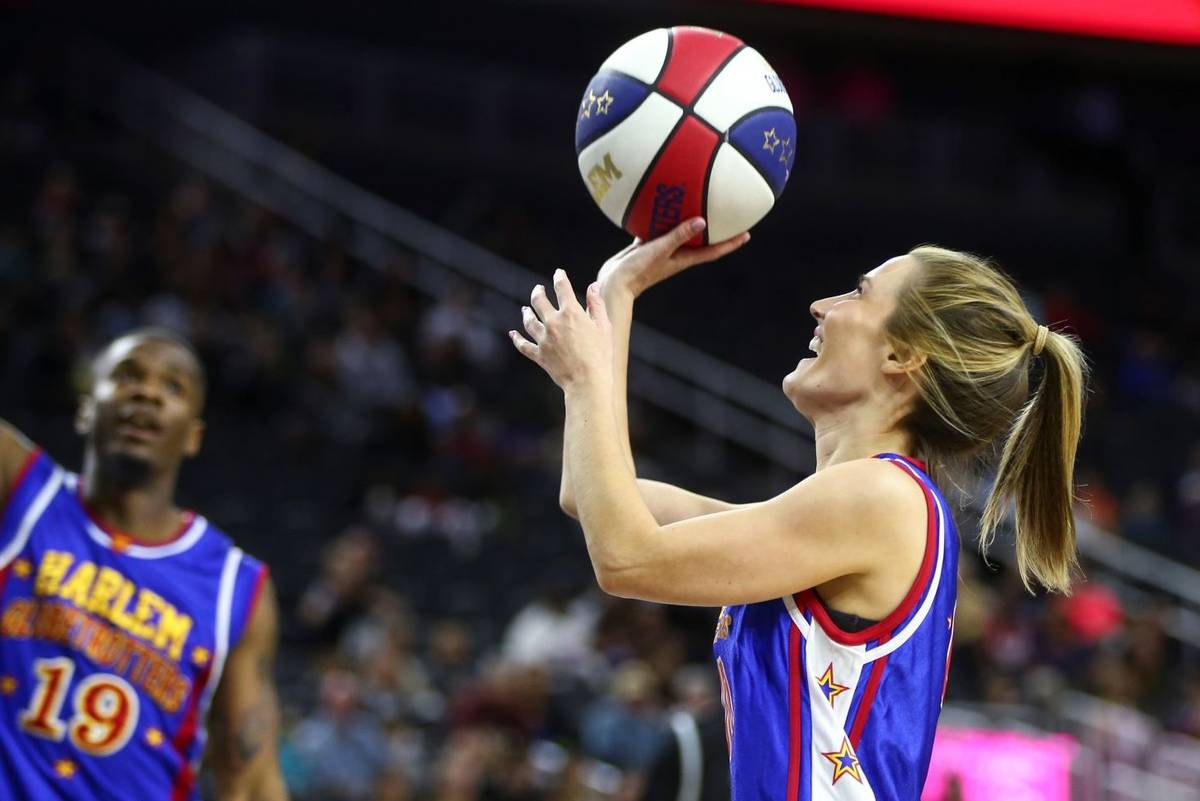 KSNV-TV reporter Amber Dixon shoots as the Harlem Globetrotters perform at T-Mobile Arena in La ...