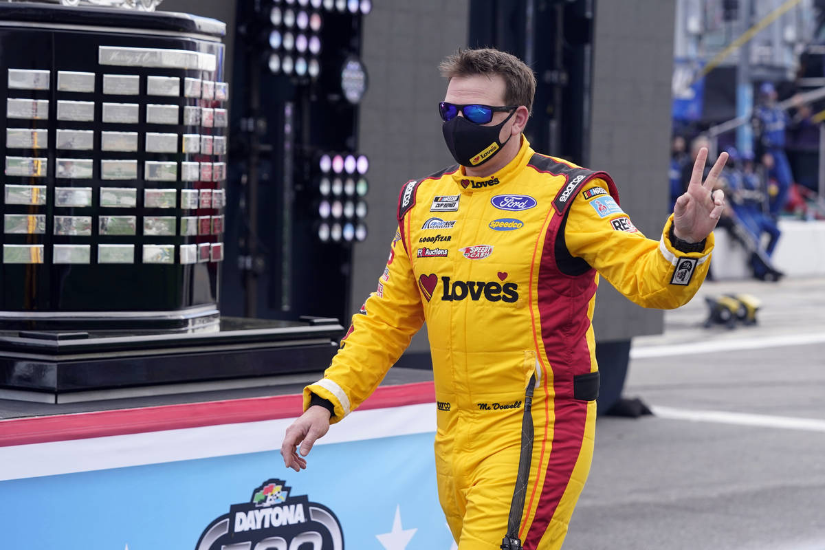 Michael McDowell walks by the championship trophy before the NASCAR Daytona 500 auto race at Da ...