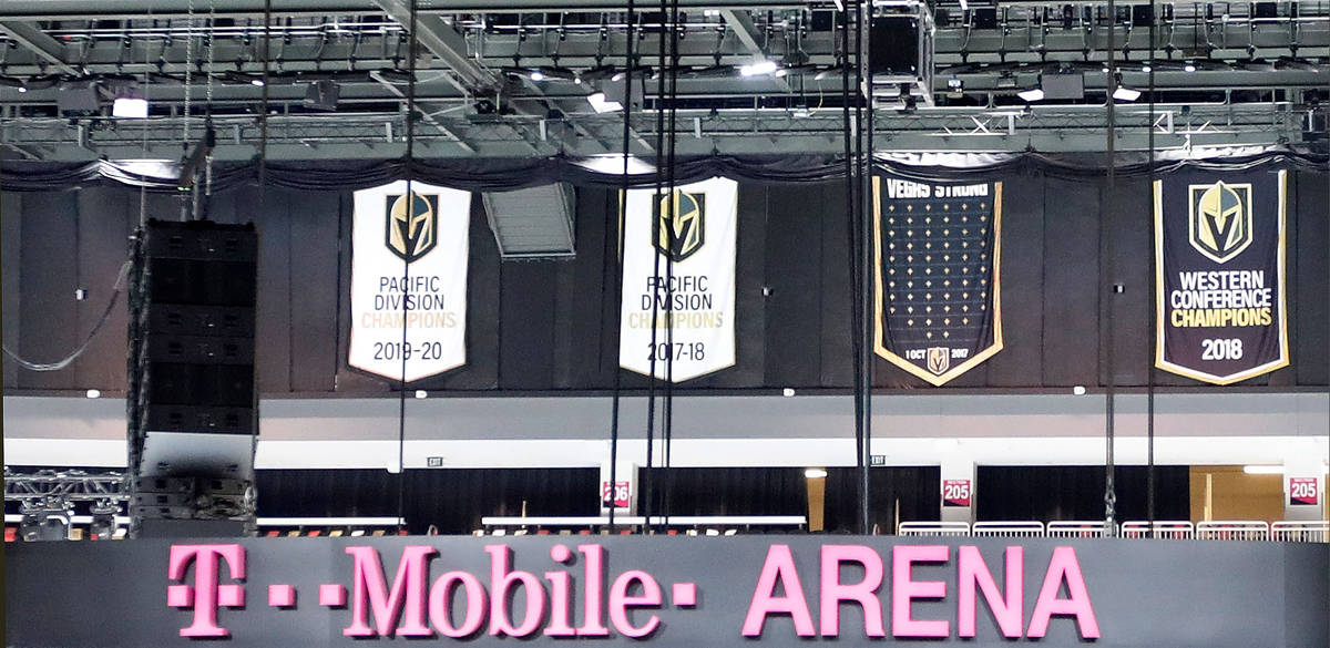The ÒVegas StrongÓ banner, second from right, is seen at T-Mobile Arena in Las Vegas, ...