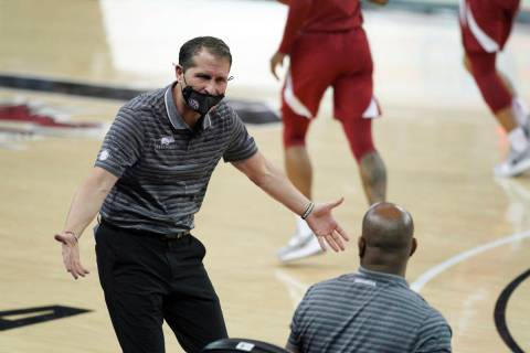 Arkansas head coach Eric Musselman communicates with players and coaches on the bench during th ...