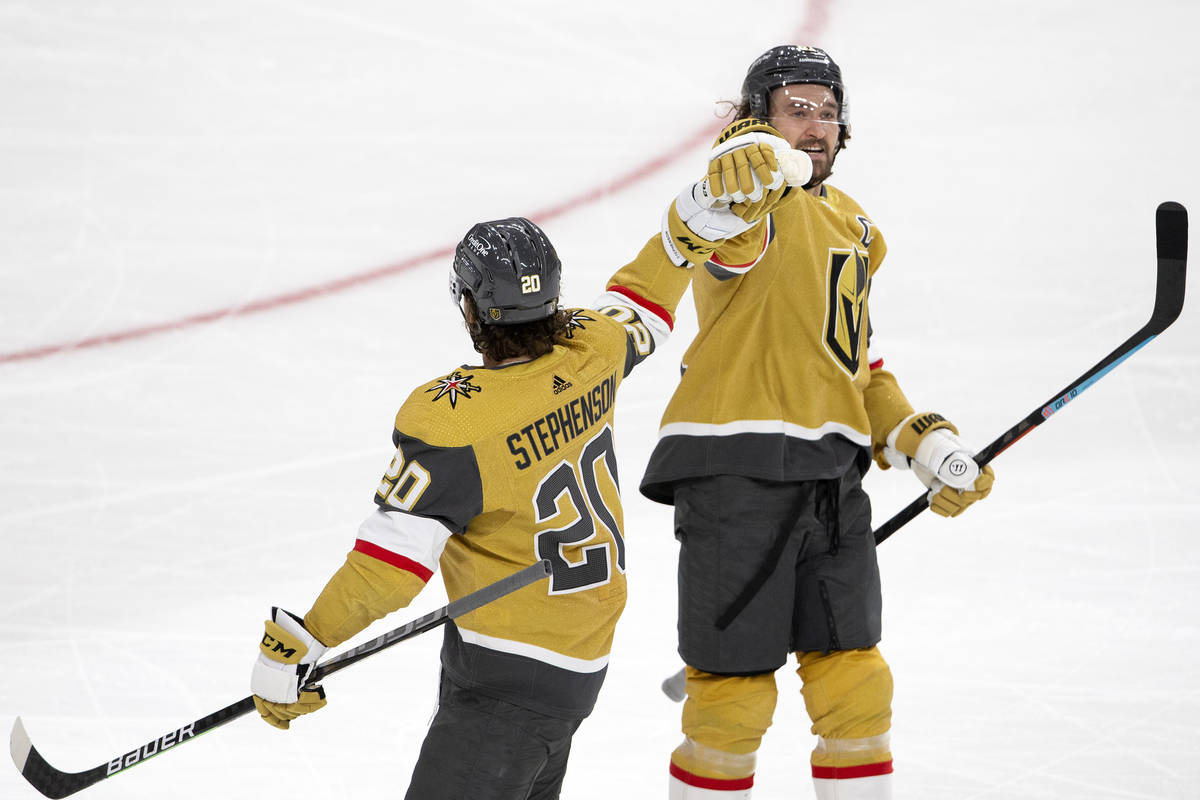 Golden Knights right wing Mark Stone (61) celebrates scoring a goal with Golden Knights center ...