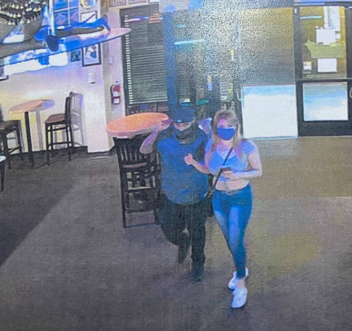 An evidence photo shows Erick Rangel-Ibarra and Lesly Palacio inside the Bourbon Street Bar at ...