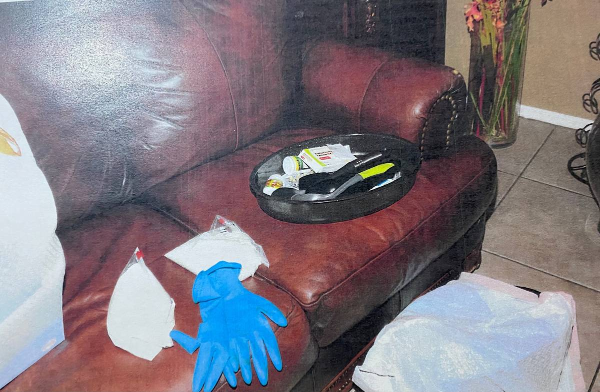 An evidence photo shows rubber gloves on a couch inside the home of Jose Rangel and his son Eri ...