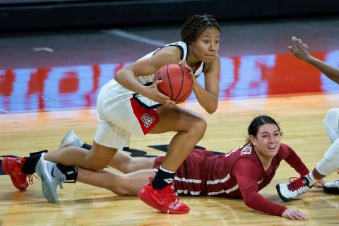 Washington State Cougars guard Krystal Leger-Walker (4) loses control of the ball as Arizona Wi ...