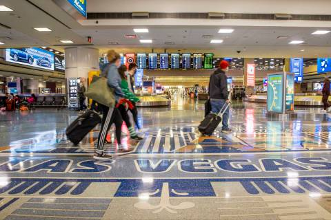 People come and go through baggage at Terminal 1 as holiday travel at McCarran International Ai ...