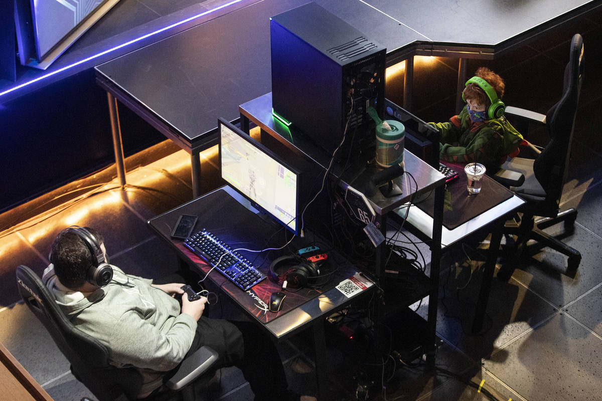 Players including Liam Lose, 7, of Las Vegas, right, get ready for the Fortnite tournament &quo ...