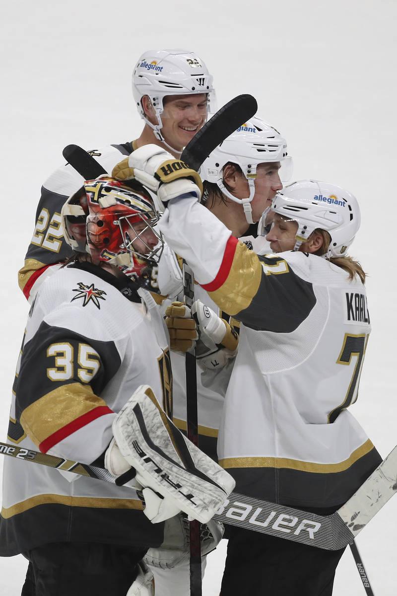 Vegas Golden Knights goaltender Oscar Dansk (35) and teammates celebrate an overtime win agains ...