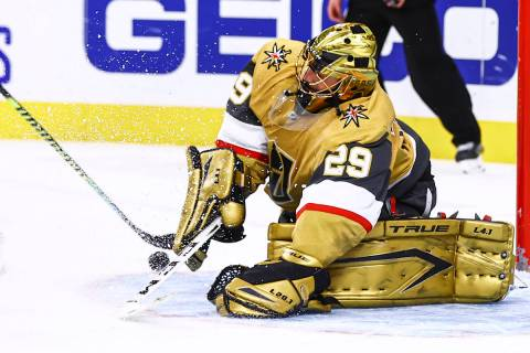 Golden Knights goaltender Marc-Andre Fleury (29) blocks the puck against the Arizona Coyotes du ...