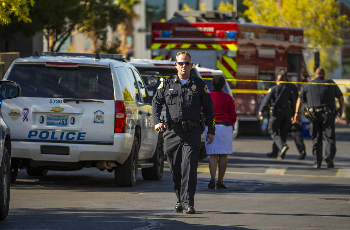 Officers work the scene of a shooting at The Equestrian on Eastern Apartments on Monday, Oct. 21, 2019, in Henderson. (L.E. Baskow / Las Vegas Review-Journal) @Left_Eye_Images