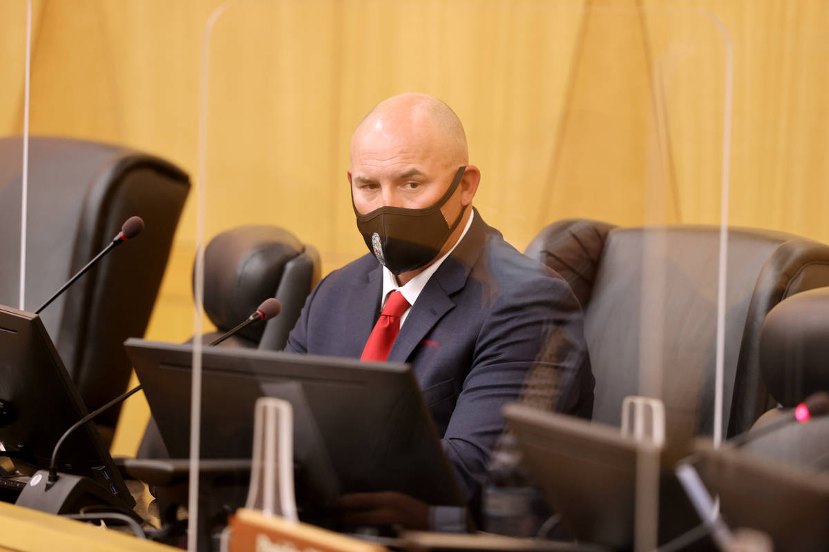 Detective Michael Condratovich watches video while testifying during a fact-finding review at t ...