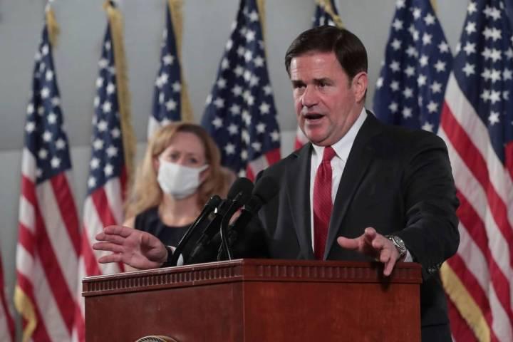 Arizona Gov. Doug Ducey addresses the media in Phoenix in November 2020. (Michael Chow/The Ariz ...