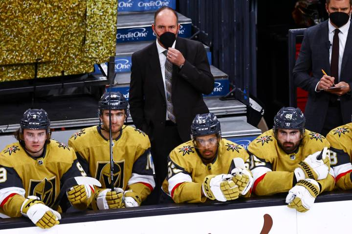 Golden Knights head coach Pete DeBoer looks on from the bench during the third period of an NHL ...