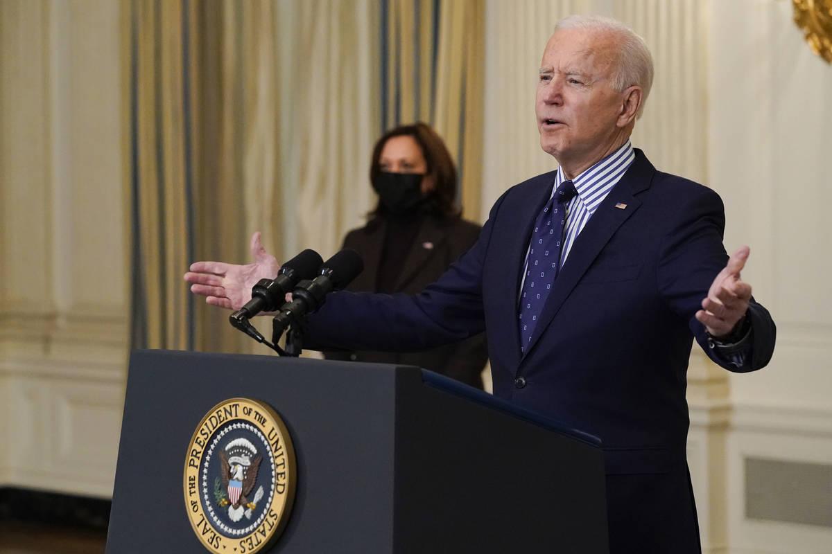 Vice President Kamala Harris, listens as President Joe Biden speaks in the State Dining Room of ...