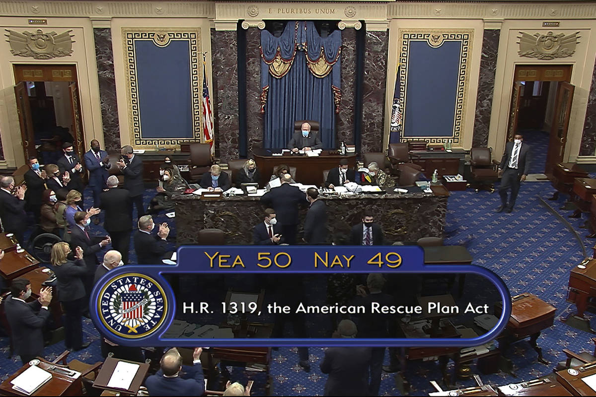 In this image from video, the vote total of 50-49 on Senate passage of the COVID-19 relief bill ...
