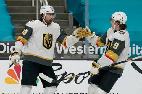 Vegas Golden Knights right wing Alex Tuch, left, is congratulated by center Cody Glass (9) afte ...
