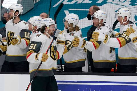 Vegas Golden Knights right wing Mark Stone (61) is congratulated by teammates after scoring a g ...