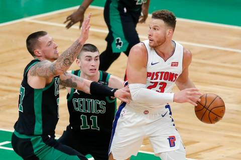 Boston Celtics' Daniel Theis (27) and Payton Pritchard (11) defend against Detroit Pistons' Bla ...