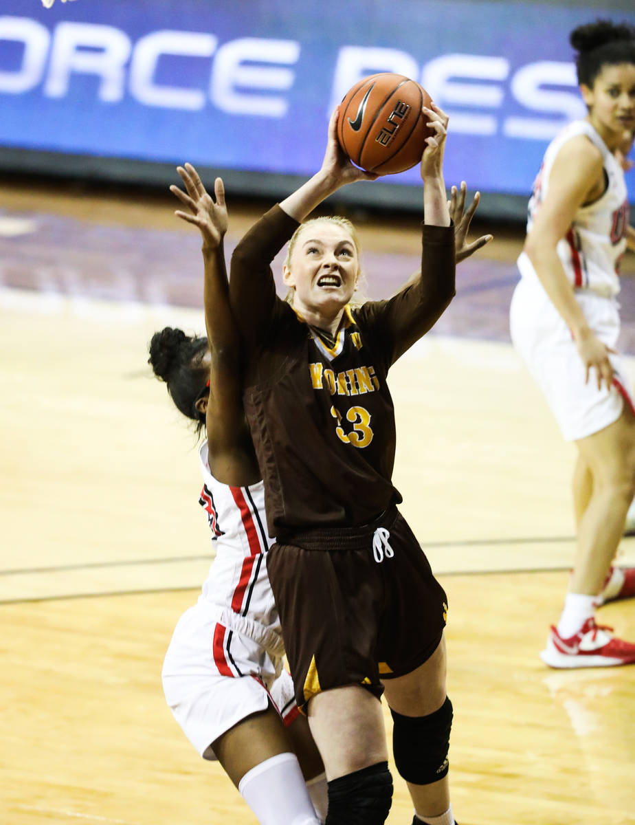 Wyoming forward Dagny Davidsdottir (33) shoots a basket past UNLV center Desi-Rae Young (23) in ...