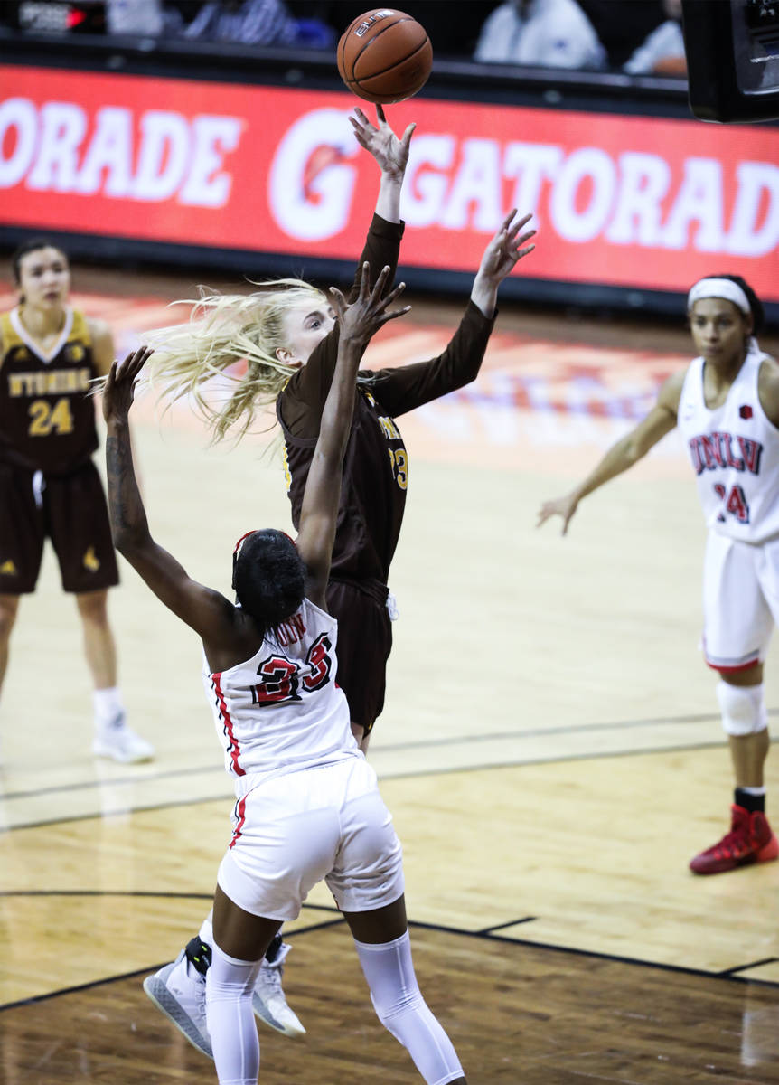 Wyoming'forward Dagny Davidsdottir (33) shoots a basket past UNLV center Desi-Rae Young (23) in ...
