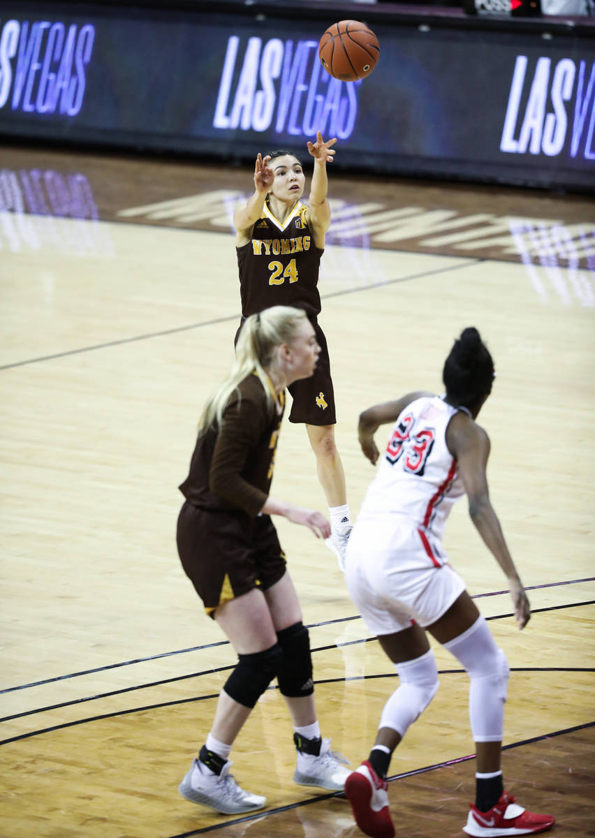 Wyoming guard Tommi Olson (24) shoots a three point field goal against UNLV in the second half ...