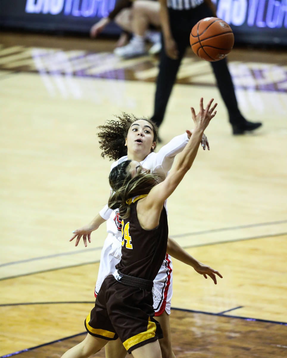 UNLV center Keyana Wilfred (15) passes the ball past Wyoming guard Tommi Olson (24) in the seco ...