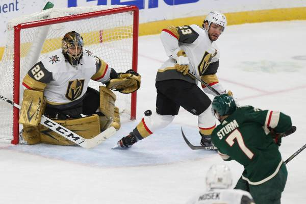 Vegas Golden Knights goalie Marc-Andre Fleury (29) watches the puck shot by Minnesota Wild's Ni ...