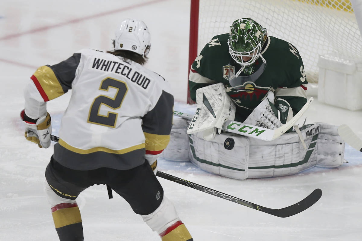 Minnesota Wild's goalie Kaapo Kahkonen (34) stops the puck shot by Vegas Golden Knights' Zach W ...