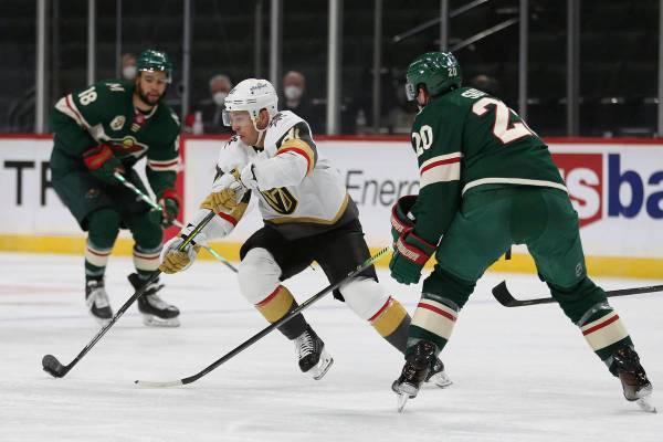 Vegas Golden Knights' Jonathan Marchessault (81) controls the puck against Minnesota Wild's Rya ...
