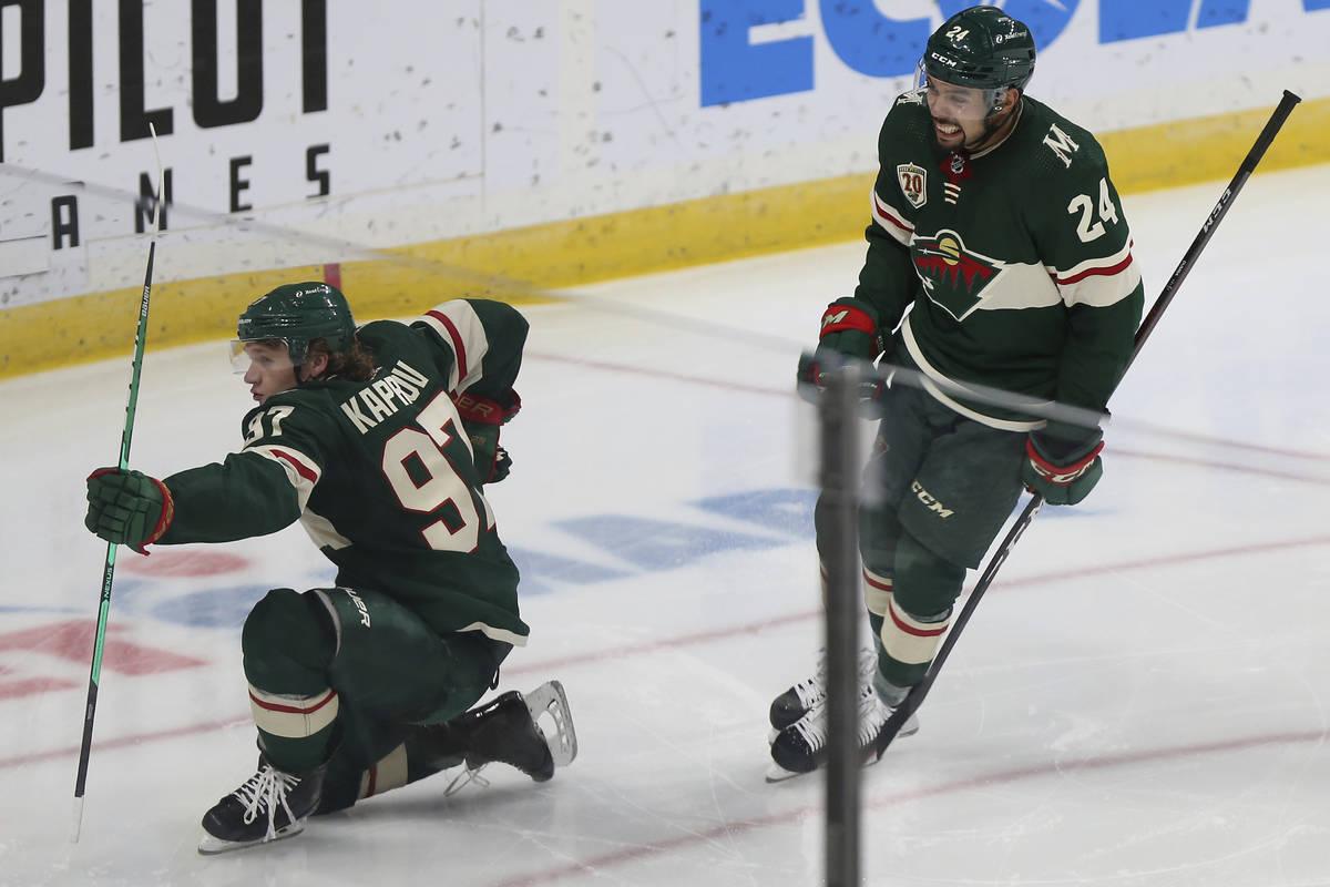 Minnesota Wild's Kirill Kaprizov (97) celebrates on the ice with Matt Dumba (24) after scoring ...