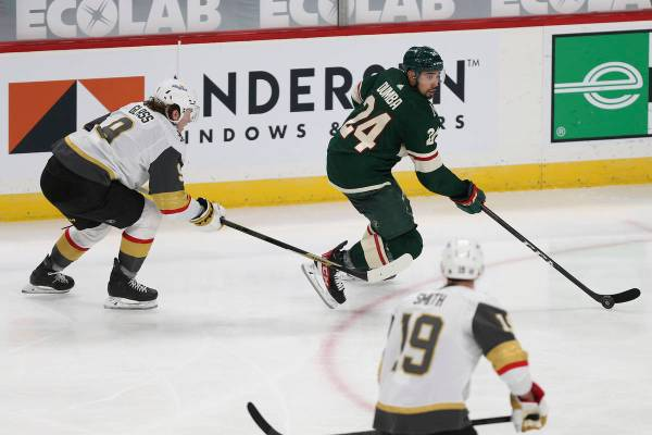Minnesota Wild's Matt Dumba (24) controls the puck against Vegas Golden Knights' Cody Glass, le ...