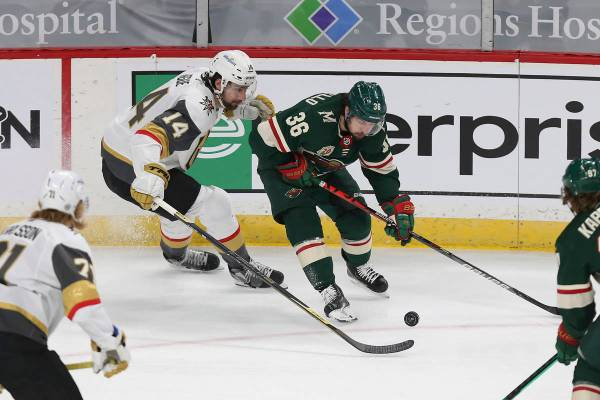 Minnesota Wild's Mats Zuccarello (36) and Vegas Golden Knights' Nicolas Hague (14) vie for the ...