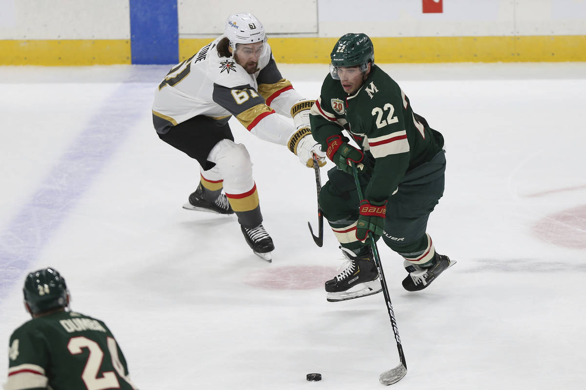 Minnesota Wild's Kevin Fiala (22) tries to maintain control of the puck against Vegas Golden Kn ...