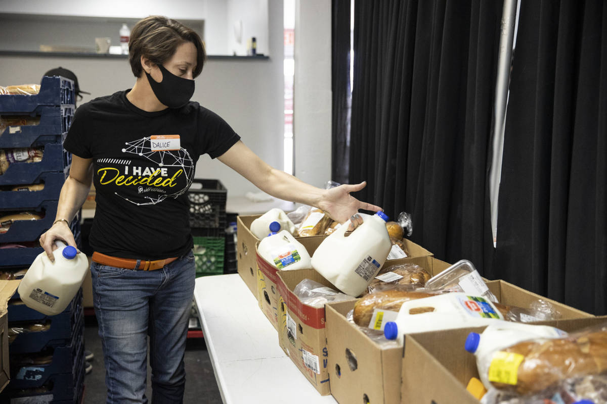 Volunteer Dalice Buchmiller puts together food boxes for people at the City Impact Urban Food B ...
