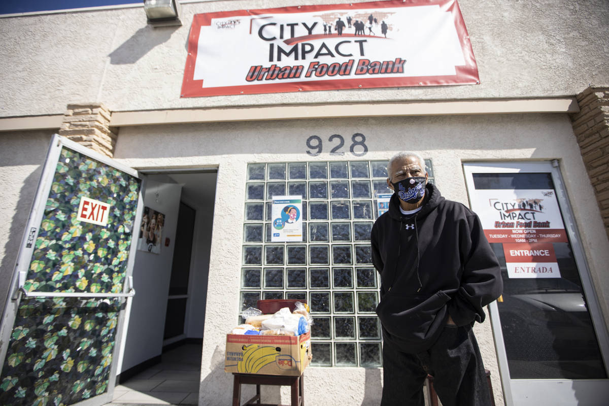 Johnny Hernandez Jr., of Las Vegas, stands outside of the City Impact Urban Food Bank in Las Ve ...