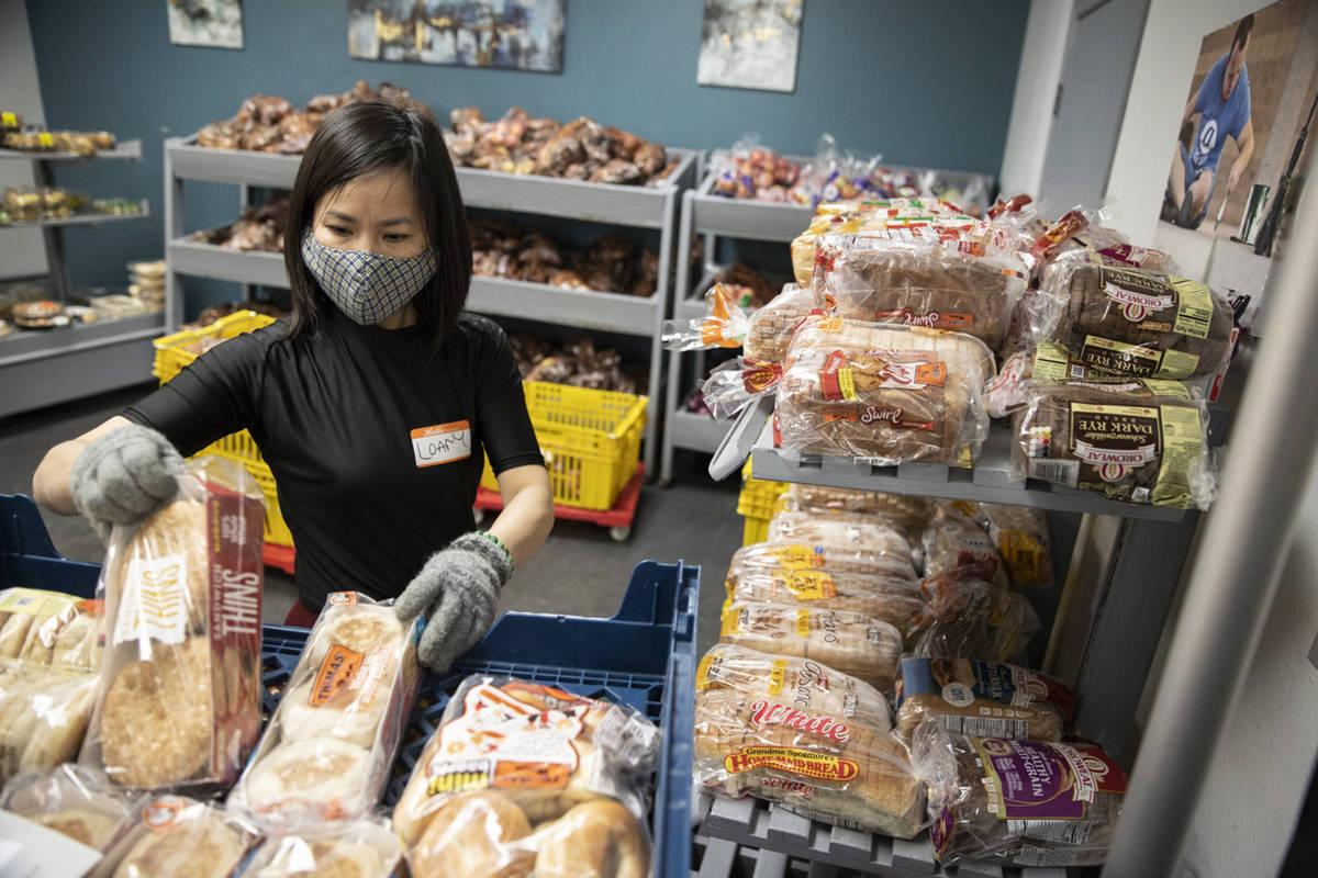 Volunteer Loan Ha organizes bread at the City Impact Urban Food Bank in Las Vegas, on Wednesday ...