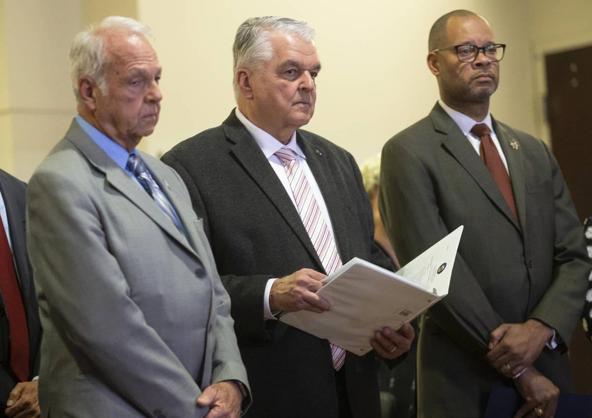 Dr. John Novak, left, District Board of Health Chair, Governor Steve Sisolak and Attorney Gener ...