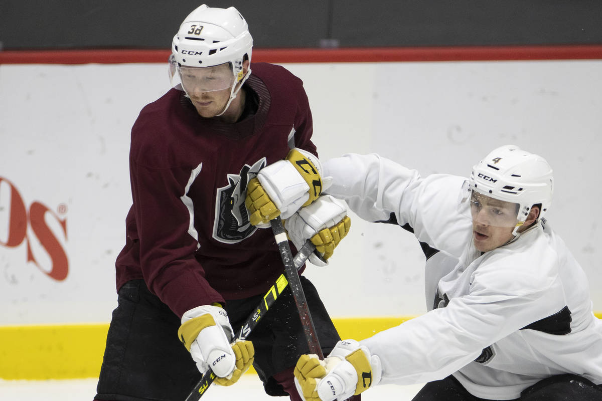 The Henderson Silver Knights' Patrick Brown (38) and Jimmy Schuldt (4) during a team practice a ...