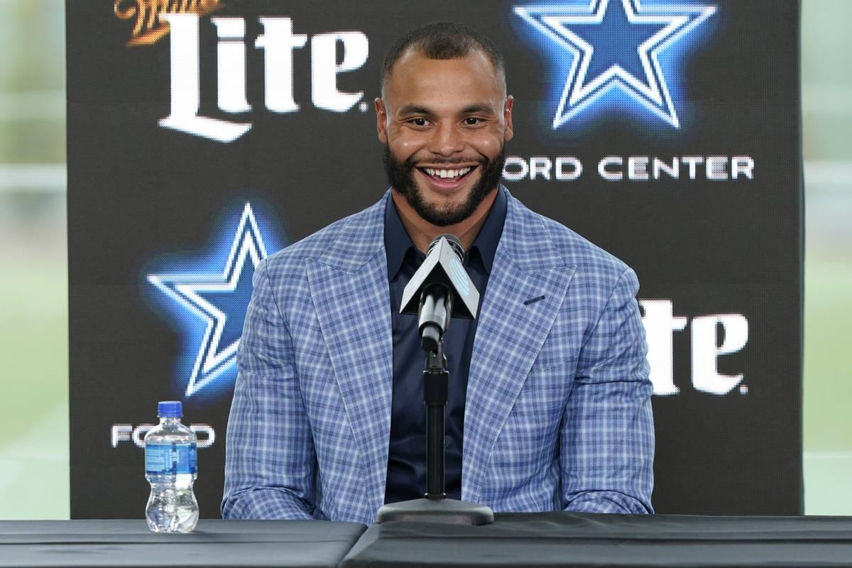 Dallas Cowboys quarterback Dak Prescott smiles during a news conference at the team's NFL footb ...