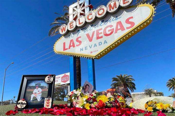 A floral arrangement is displayed at the famous Welcome to Las Vegas sign on March 1, 2021, in ...